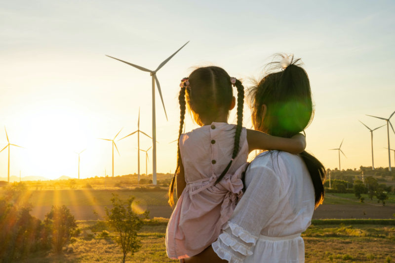 wind turbines, child and mother