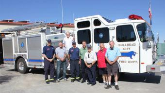 Board members standing next to Bullhead City Fire Department fire truck