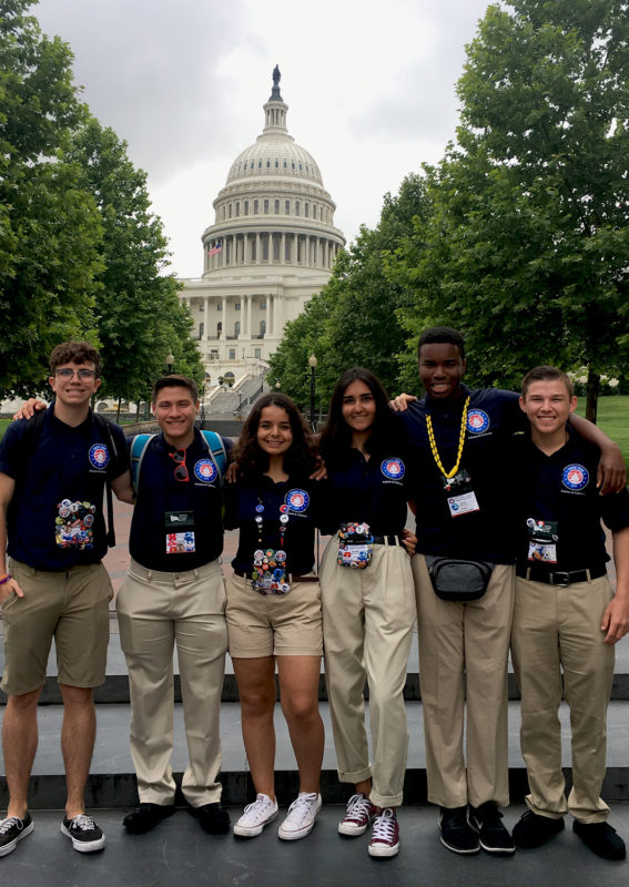 Group of students standing in front of the Capitol Building.