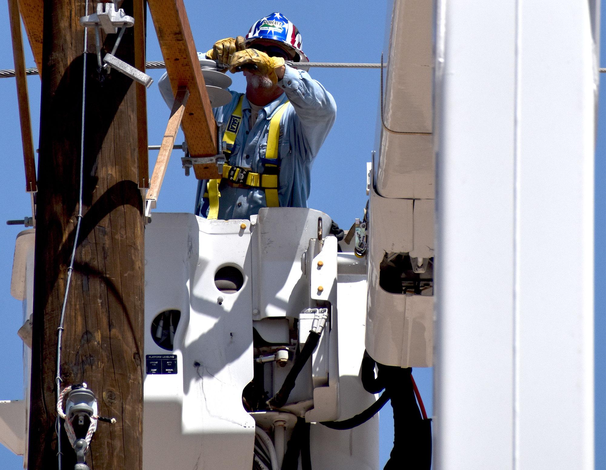 Lineman working on power pole