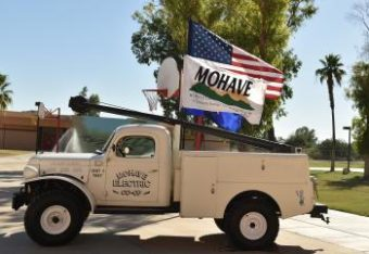 A truck with an American flag, along with the Mohave flag.