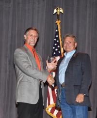 CEO Tyler Carlson presenting an award to Sen. Sonny Borrelli.