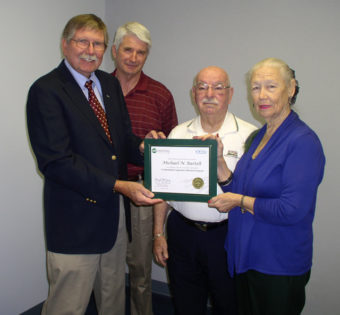 Board member Michael Bartelt getting his accredited Credentialed Cooperative Director Certificate