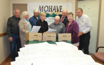 Board members with boxes of letters