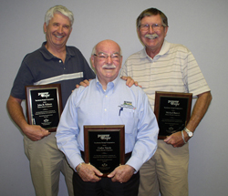 John Nelssen, Carlos Tejeda, and Michael Bartelt display plaques awarded to them for the Touchstone Energy Power and Hope Award