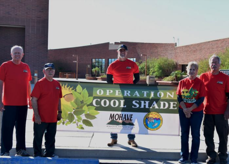 Group with Operation CoolShade banner