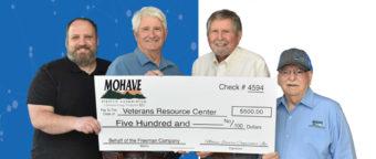 Veterans Resource Center receiving check from MEC